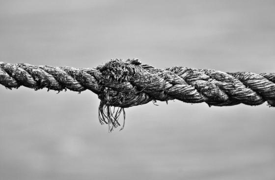 Frayed, taut rope